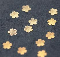 Gold Snow Flakes/Blossoms cut from edible soluble film